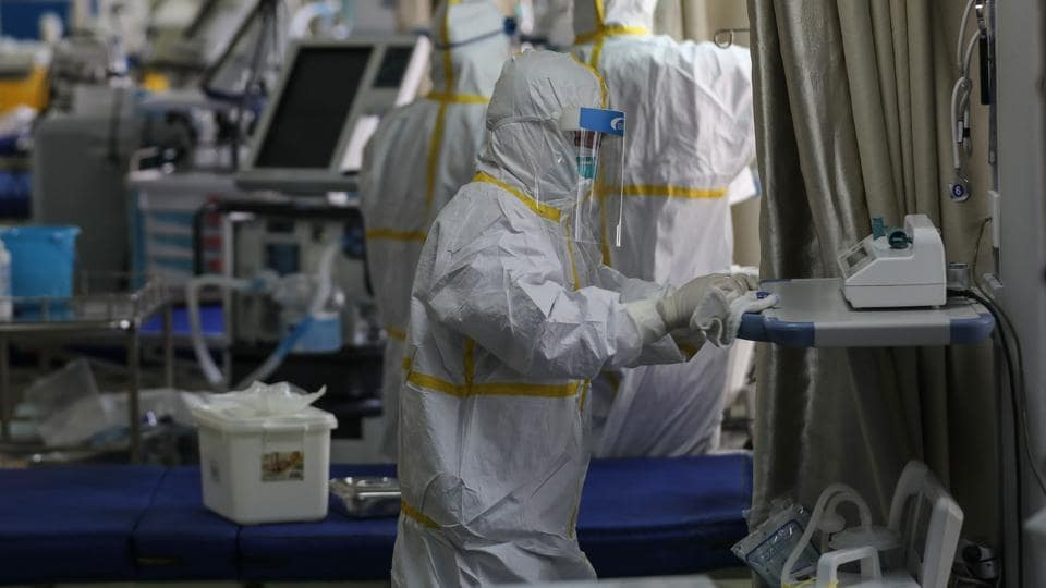 A medical staff member disinfects equipments at a ward used to be an isolation ward for patients infected by the COVID-19 coronavirus at a hospital in Wuhan in China's central Hubei province on March 12, 2020.
