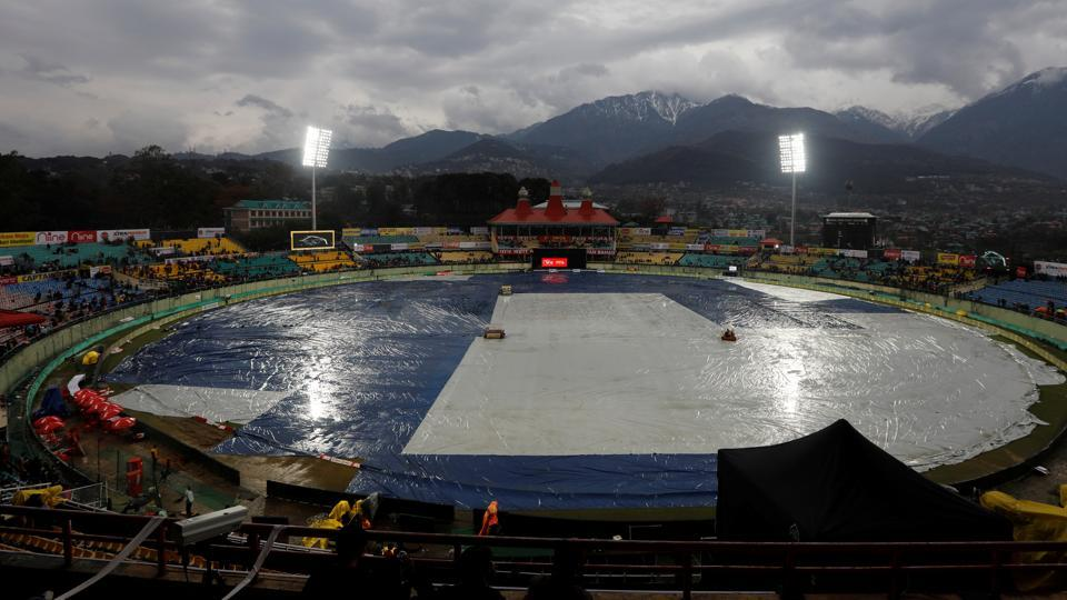 Cricket - India v South Africa - First ODI - Himachal Pradesh Cricket Association Stadium, Dharamsala, India - March 12, 2020 General view inside the stadium as the pitch is covered during the rain delay to the start of the match
