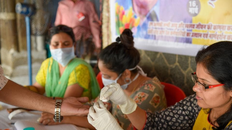 People wear face mask to protect against coronavirus, Mumbai, March 12, 2020