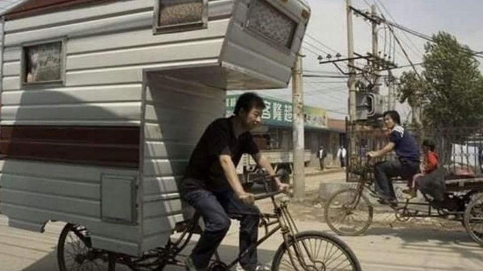 Anand Mahindra posted a picture of a man cycling with what appears to be a single unit caravan home attached to his two-wheeler.