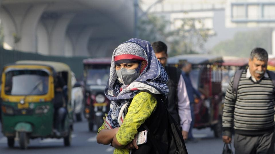 People wear protective masks in Noida on Tuesday after reports of more coronavirus positive cases in the country,