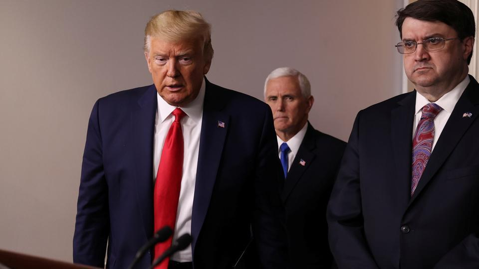 US President Donald Trump is accompanied by Vice President Mike Pence and Veterans Affairs Secretary Robert Wilkie as he arrives for the daily coronavirus response briefing at the White House in Washington, on March 18.