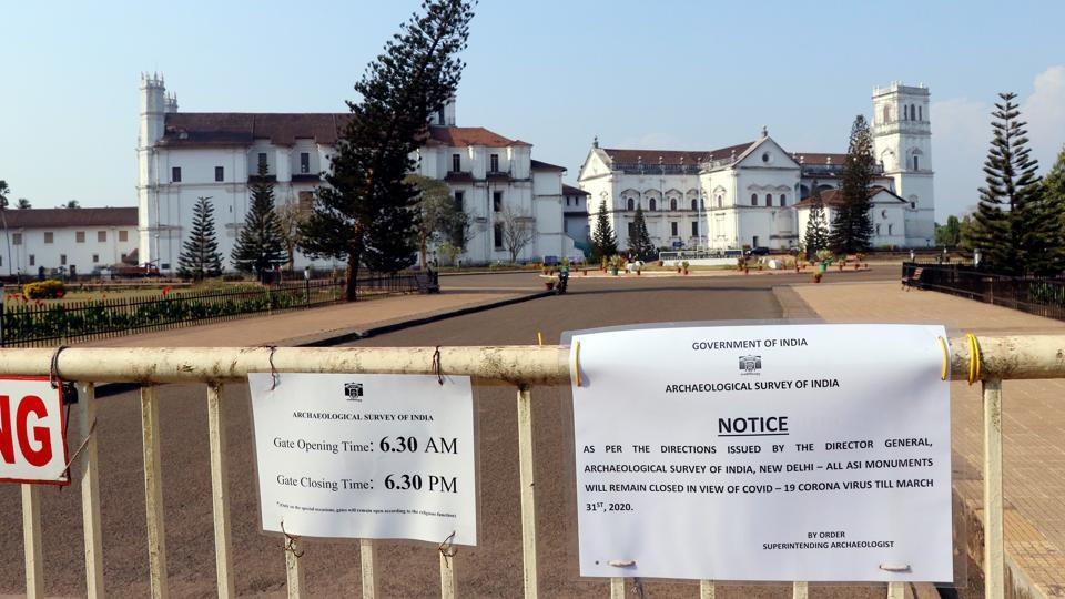 A notice board put for the closure of Church of St. Augustine as a precautionary measure amid the coronavirus outbreak, in Old Goa on Wednesday.