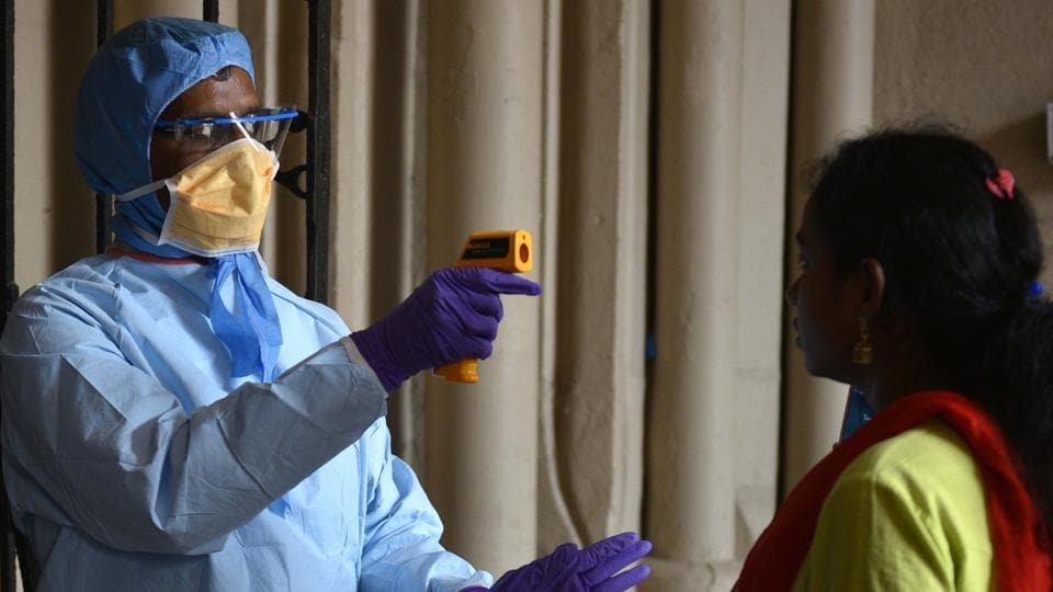 A doctor of West Bengal Health Department conducts thermal screening as prevention from Covid-19 at Kolkata High Court on March 17.
