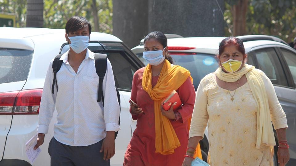 People wearing protective face masks as precautionary measure amid rising coronavirus concerns, at Civil Hospital, in Gurugram, on March 19.
