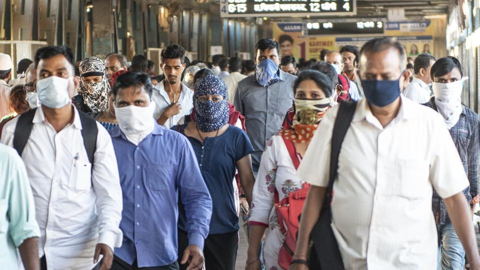 People cover their face as precautionary measure against corona virus at Kurla Station, Kurla, Mumbai, on March 19, 2020. (Photo by Aalok Soni/Hindustan Times)