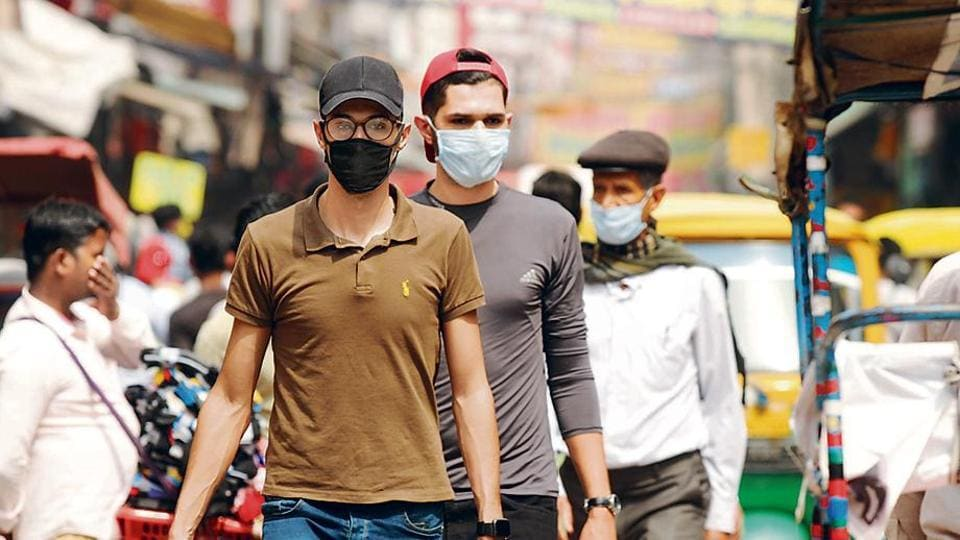People wearing protective face masks as a precaution against coronavirus in Gurugram, India.
