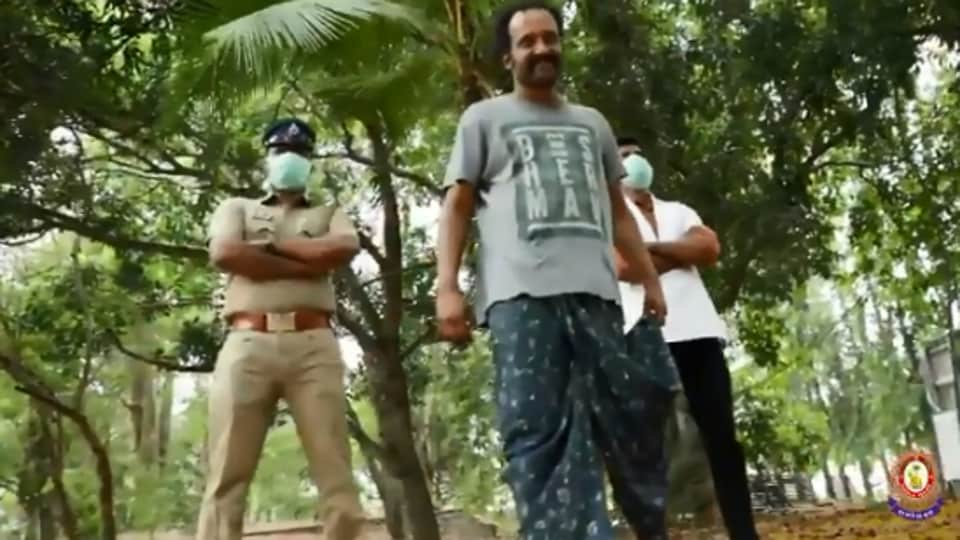 The image shows a scene from the PSA video by Kerala Police.