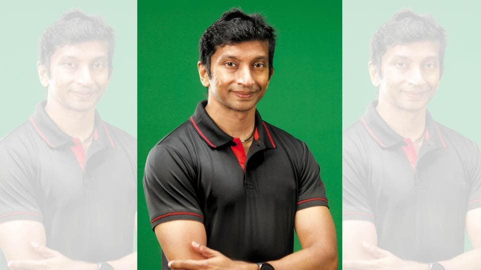 Narain Karthikeyan is India's first Formula One driver; T-shirt, Lotto; necklace, Phiten Titanium; watch, Polar