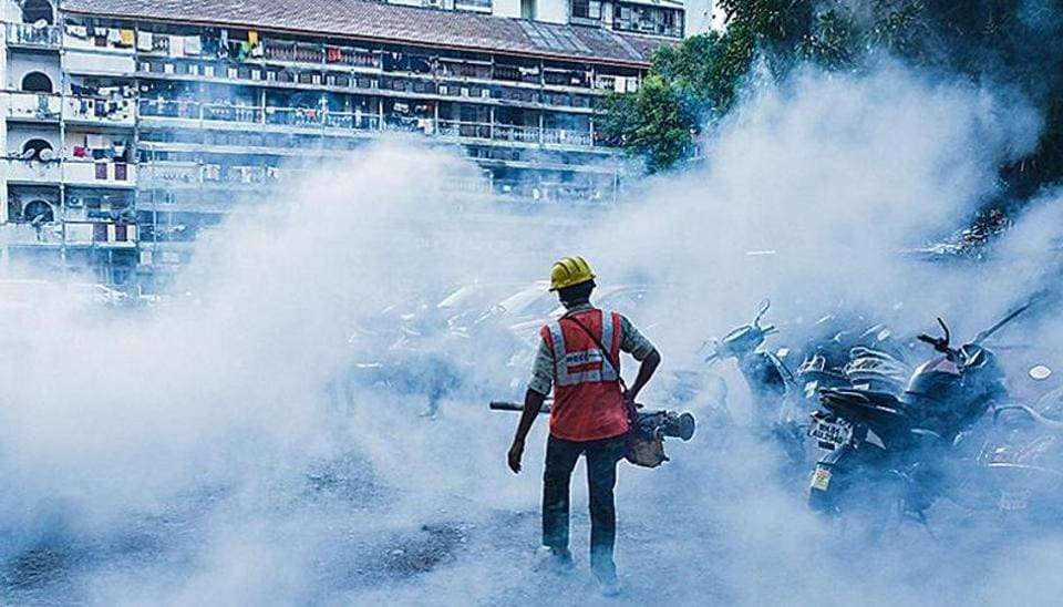 A worker carries out fumigation at Grant Road in Mumbai on January 15.