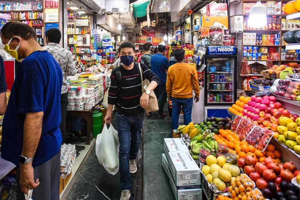 Coronavirus in India: People in face masks throng to stock up on groceries amid a coronavirus fuelled panic, at INA Market, in New Delhi.