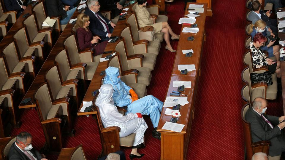 Veselin Mareshki, leader of Bulgarian party Volya (Will), and a deputy from his party wear protective suits during a debate in the parliament in Sofia. (Dimitar Kyosemarliev / REUTERS)