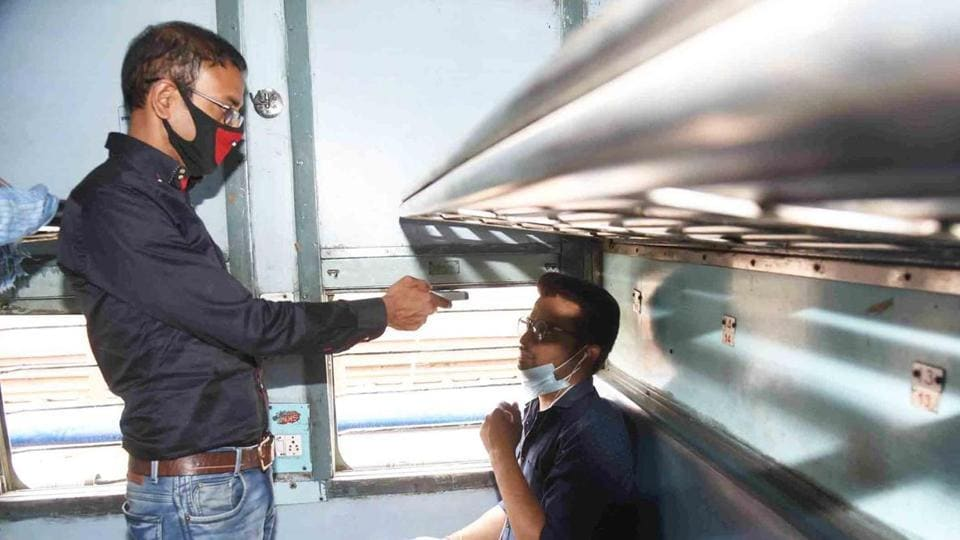 A railway staff conducts thermal screening in wake of coronavirus concerns, at Patna Junction.