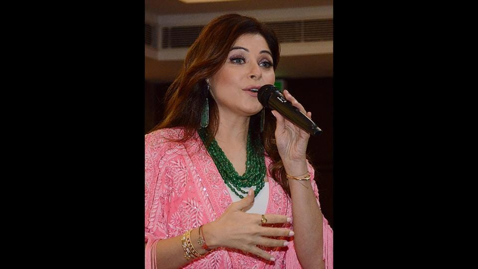 File Photo: Bollywood singer Kanika Kapoor performs during Karva Chauth celebrations in Amritsar. Kapoor became the first Bollywood celebrity to test positive for coronavirus. (Narinder Nanu / AFP)