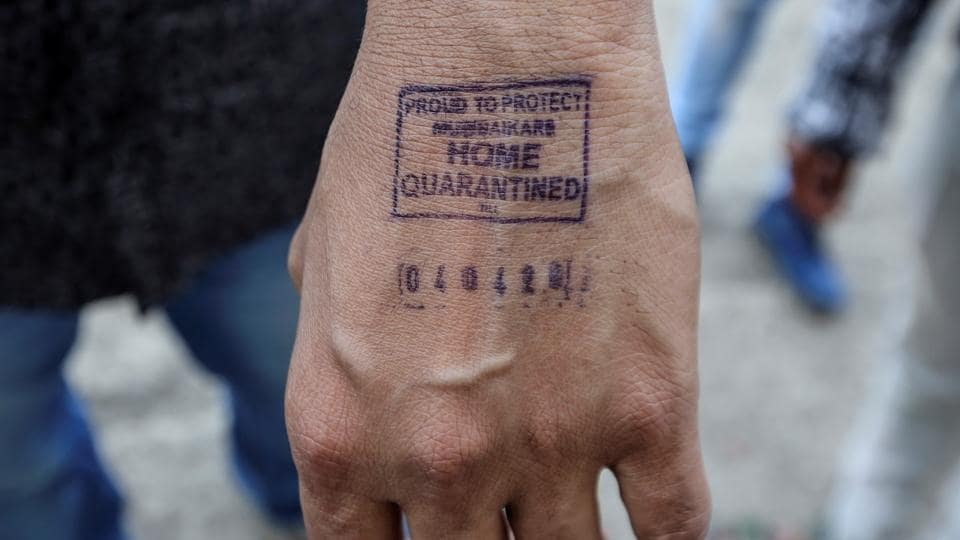 A man shows his hand -- stamped by airport authorities as he was advised for self quarantine due to international travel history amid rising coronavirus concerns in Mumbai. (Prashant Waydande / REUTERS)