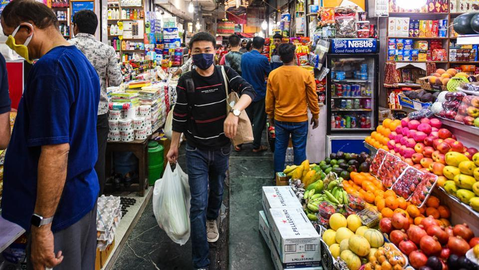 People in face masks throng to stock up on groceries amid a coronavirus fuelled panic at INA Market, in New Delhi. (Amal KS / HT Photo)