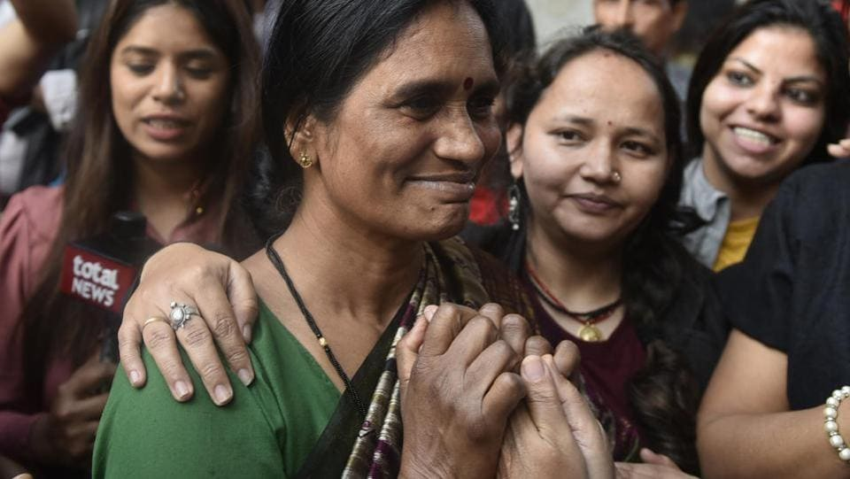 Asha Devi, mother of the 2012 Delhi gang rape victim celebrates with her neighbours at her residence after the four convicts were hanged, in Dwarka. The four convicts were hanged to death on Friday at 5.30 am inside Tihar's jail number 3. (Vipin Kumar/HT Photo)
