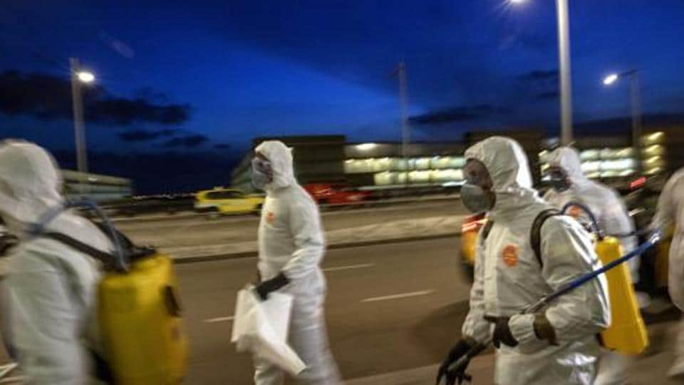 Spanish UME (Emergency Army Unit) soldiers walk as they disinfect the terminal one to prevent the spread of coronavirus at the airport of Barcelona, Spain on March 19, 2020.