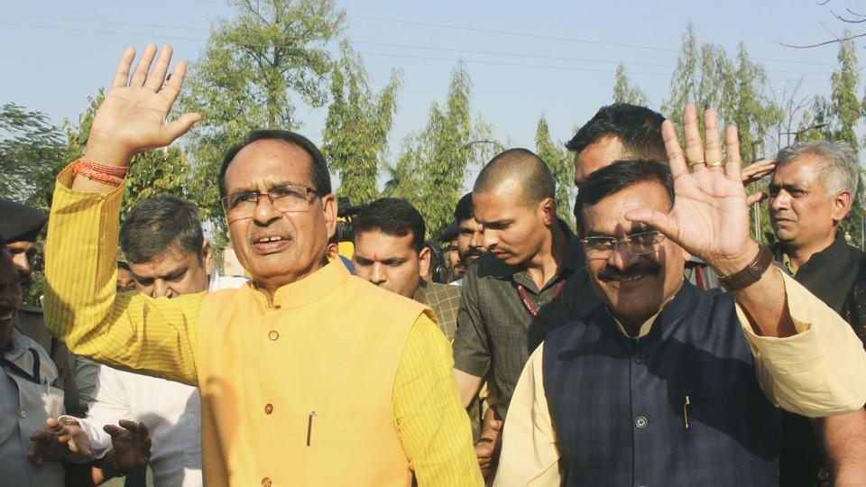 BJP National Vice President Shivraj Singh Chouhan  and others comes out after meeting with Madhya Pradesh Governor Lalji Tandon, at Raj Bhavan in Bhopal, Tuesday, March 17, 2020.