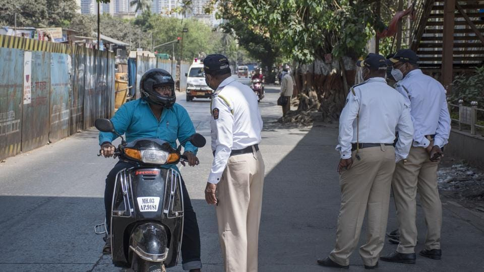 Traffic police checking due to Covid 19 pandemic at Bhandup in Mumbai on March 23, 2020.