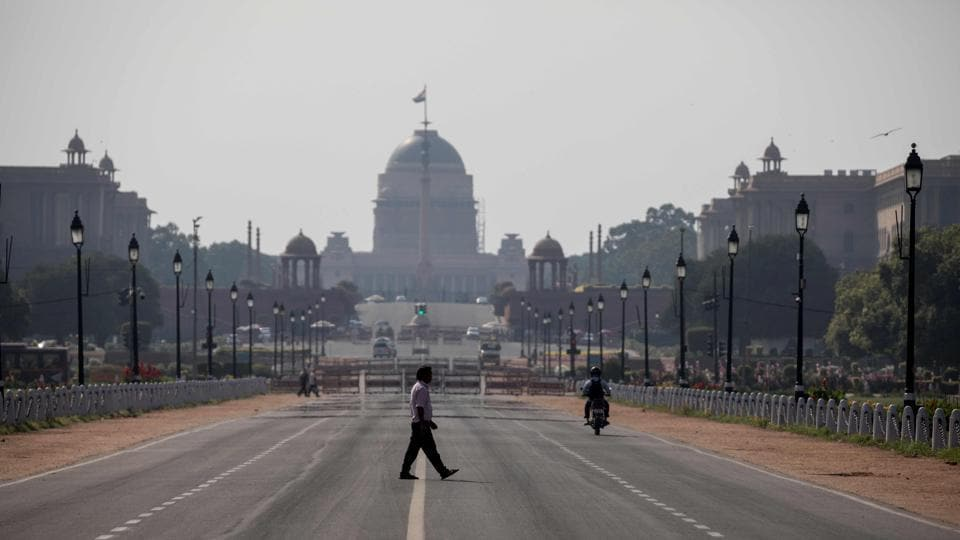 A man crosses a deserted Rajpath in NEw Delhi on Sunday during one-day Janta Curfew imposed as a preventive measure against the Covid-19 outbreak.