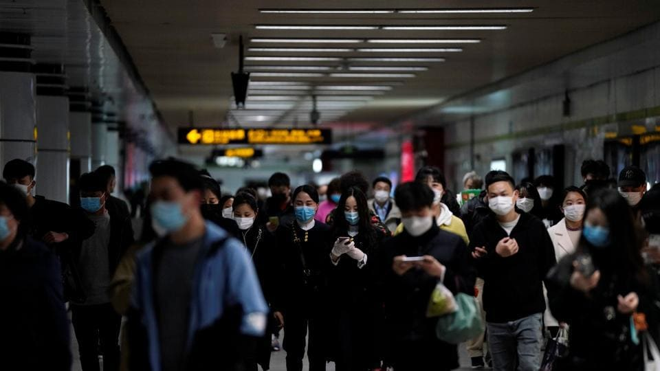 Passengers wearing face masks are seen at a subway station in China' Shanghai after the city's emergency alert level for coronavirus disease Covid-19)was downgraded, on March 23.
