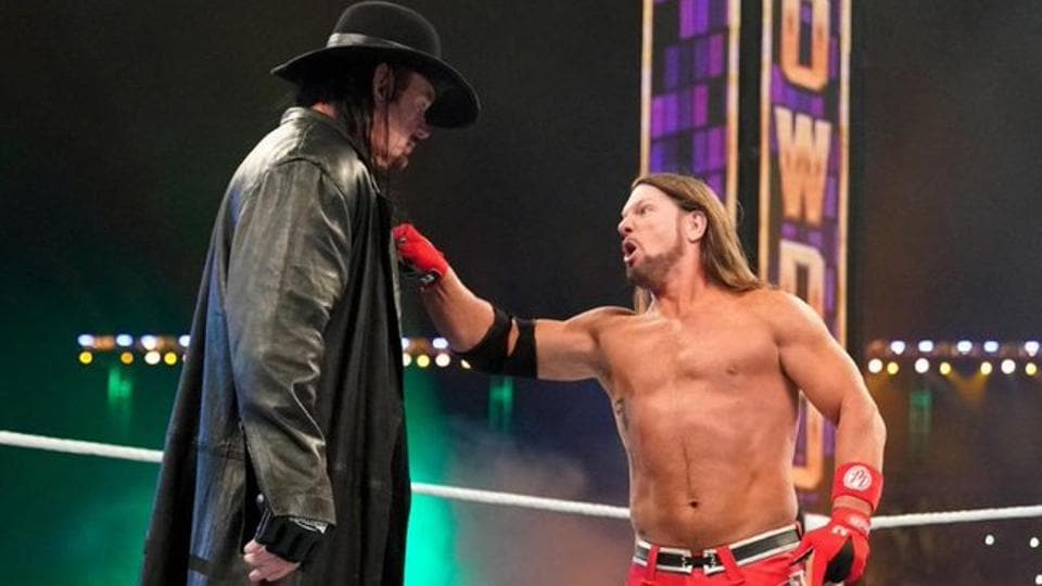The Undertaker (L) and AJ Styles.