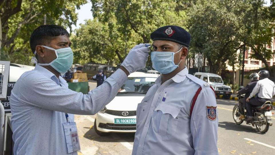 Thermal screening is conducted in the wake of deadly coronavirus pandemic, at the entrance gate of Parliament, in New Delhi on  March 23, 2020.