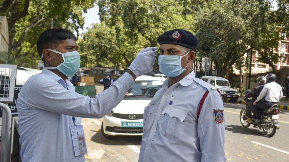 Thermal screening is conducted in the wake of deadly coronavirus pandemic, at the entrance gate of Parliament in New Delhi on Monday.