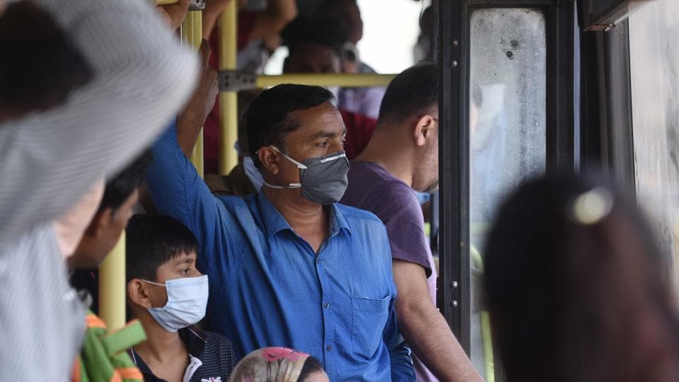 People seen wearing protective masks inside an overcrowded DTC bus during the first day of lockdown imposed by the state government to control the spread of coronavirus in New Delhi on Monday.
