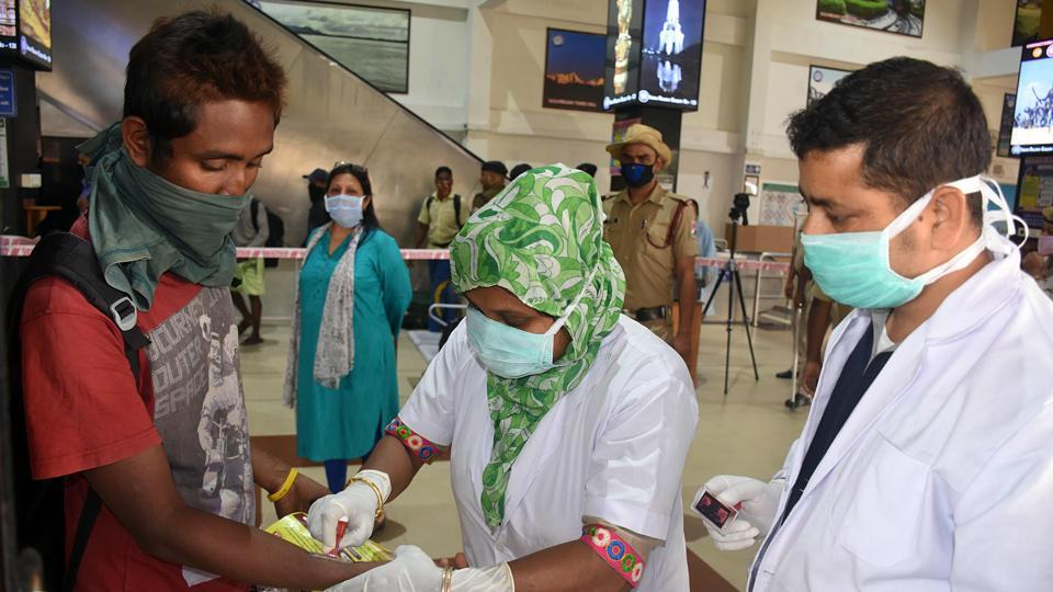 A medical professional  putting a home quarantine stamp  on a passenger amid coronavirus outbreak, in Guwahati on Monday, March 23, 2020. Manipur recorded the first confirmed Covid-19 case of northeast India on Tuesday, Mar 24.