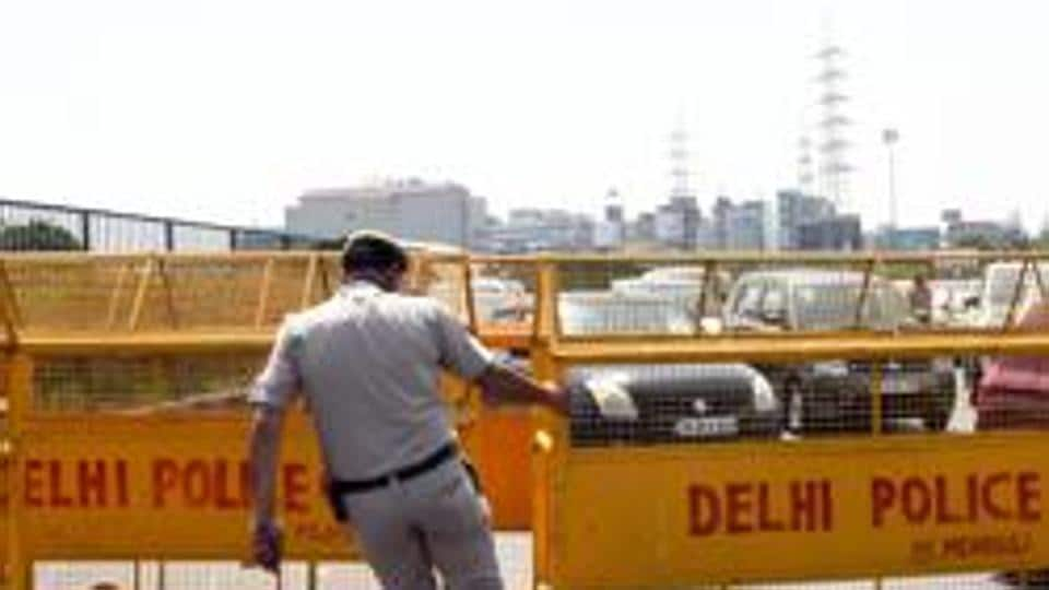 Policemen stop and check ID cards of commuters on the Gurgaon-Delhi border after lockdown in Gurgaon, March 23, 2020