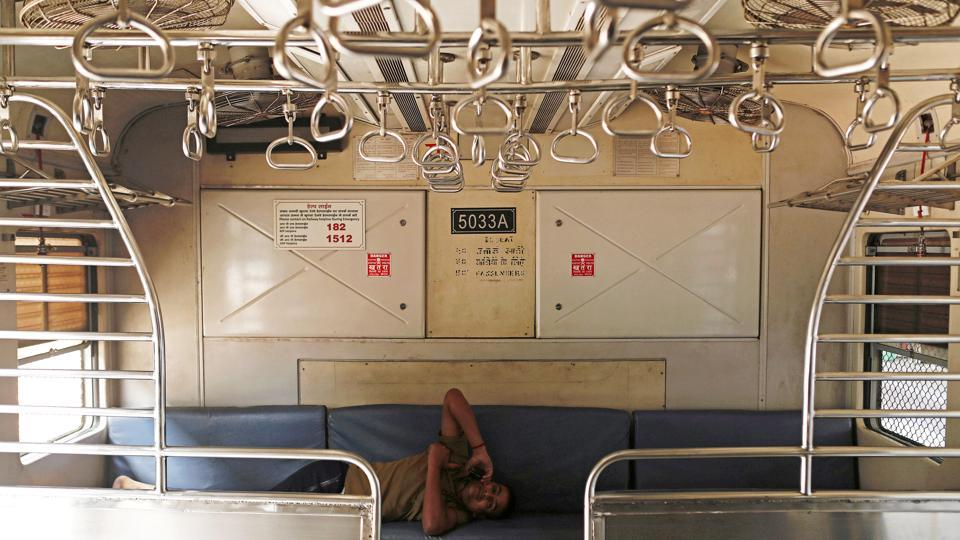 A railway employee talks on the phone inside an empty train compartment after railway services were shutdown by the authorities to limit the spread of the coronavirus disease (COVID-19) in Mumbai.  (REUTERS)