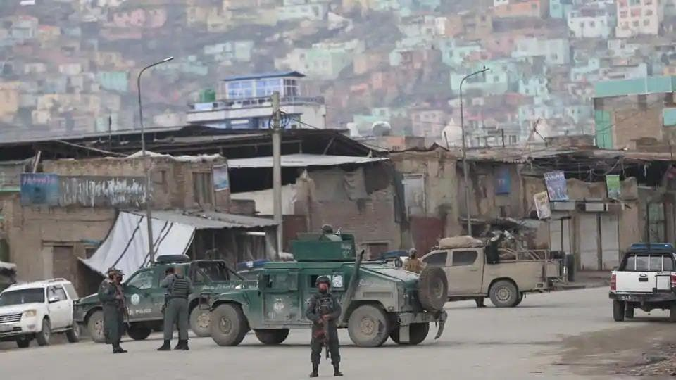 Afghan police after gunmen stormed a religious gathering of Afghanistan's minority Sikhs in their place of worship in the heart of the Afghan capital's old city on Wednesday.