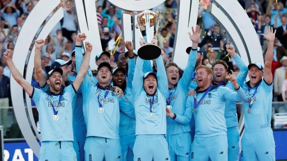 England players celebrate with the ICC World Cup trophy.