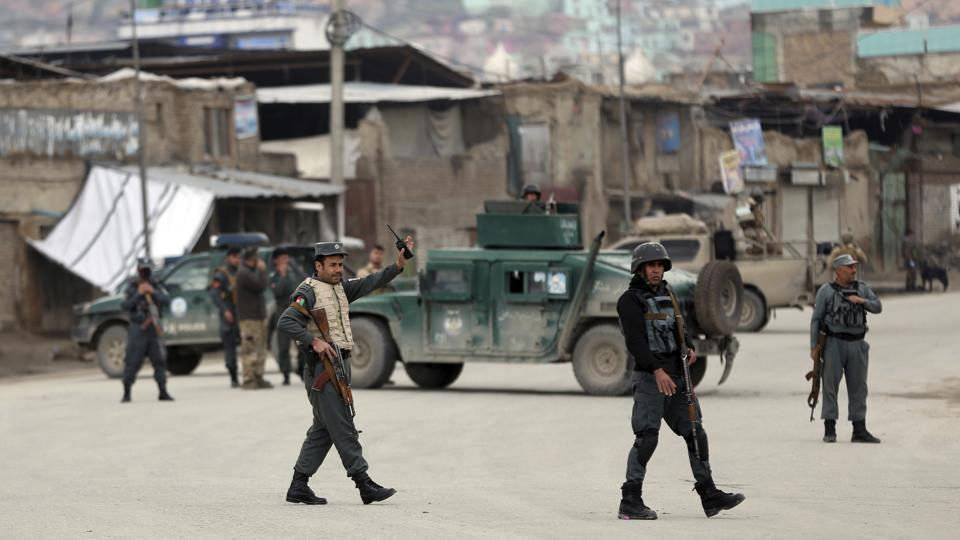 Security personnel arrive at the site of an attack in Kabul, Afghanistan, on Wednesday.