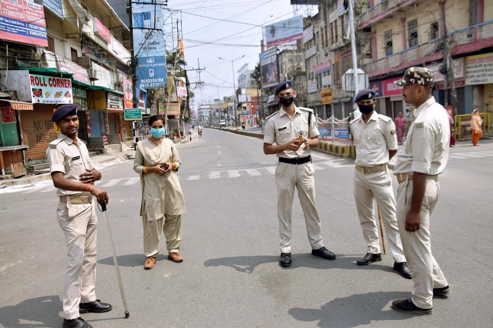Patna-March.25,2020-Police personnel watching the situation at Dak Bungalow crossing in Patna during nationwide lockdown in wake of the Coronavirus Pandemic. Bihar India on Wednesday, March 25, 2020.