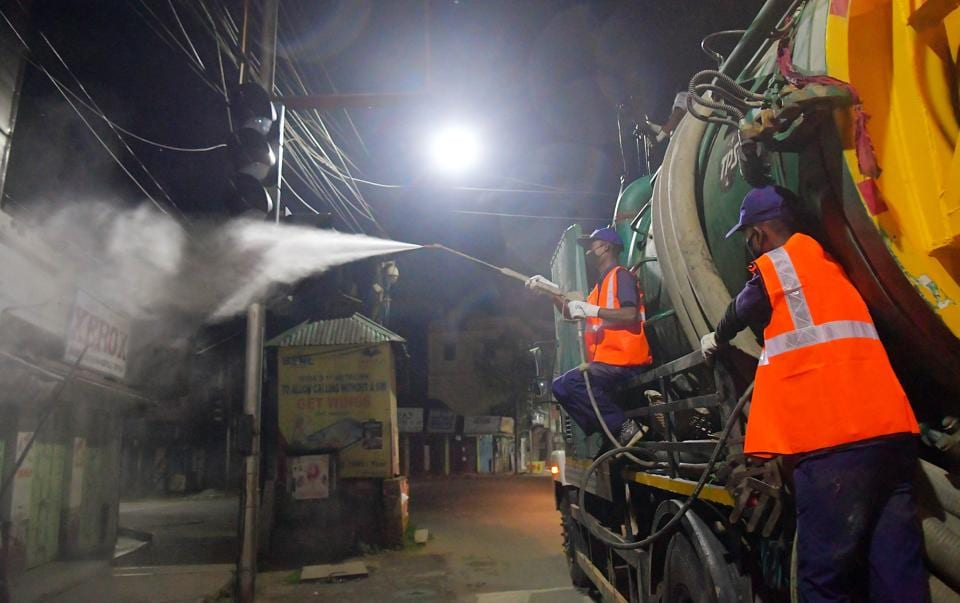 Municipal workers spray disinfectant in Agartala to check the spread of coronavirus