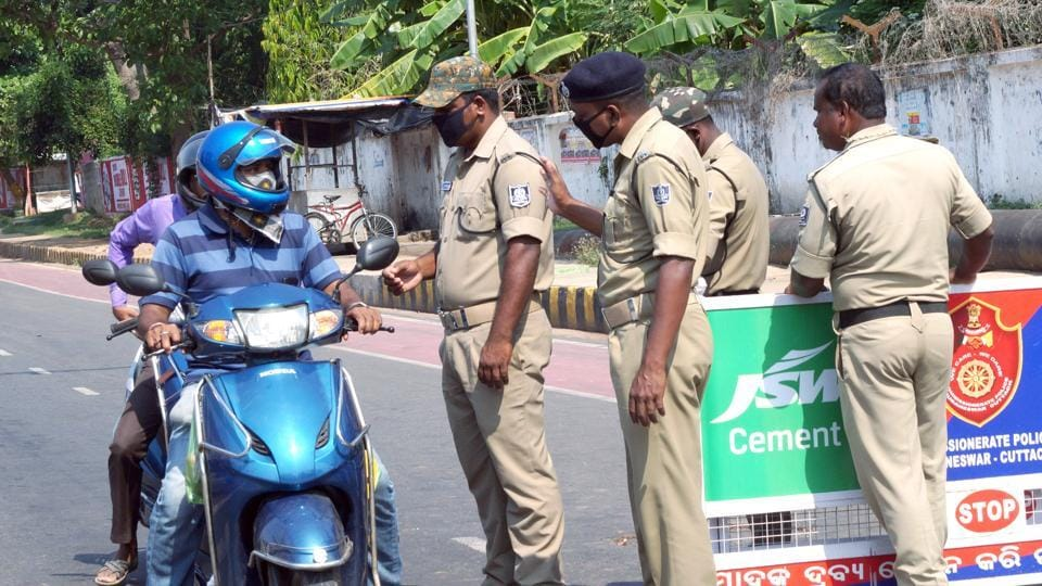 Police personnel stop vehicles for enquiry during the lockdown amid rising cases of COVID-19 Novel Coronavirus in Bhubaneswar on Tuesday, March 24, 2020.