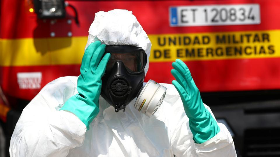 A member of Emergency Military Unit (UME) prepares to disinfect in a special facility for psychically disabled people during the coronavirus disease (COVID-19) outbreak in Getafe, Spain.