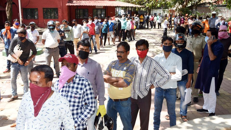 Covid-19 update: Queue of people in Jharkhand's Ranchi to purchase mask and sanitizer sold on subsidized rate during the first day of national lockdown in India to curb the spread of coronavirus.