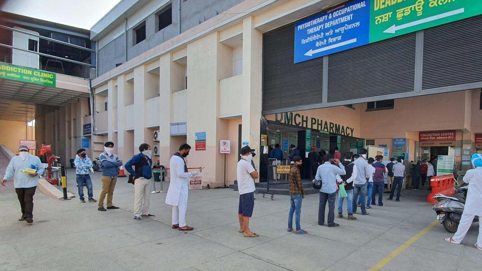 People queue up to buy medicines at Dayanand Medical College and Hospital in Ludhiana on Thursday.