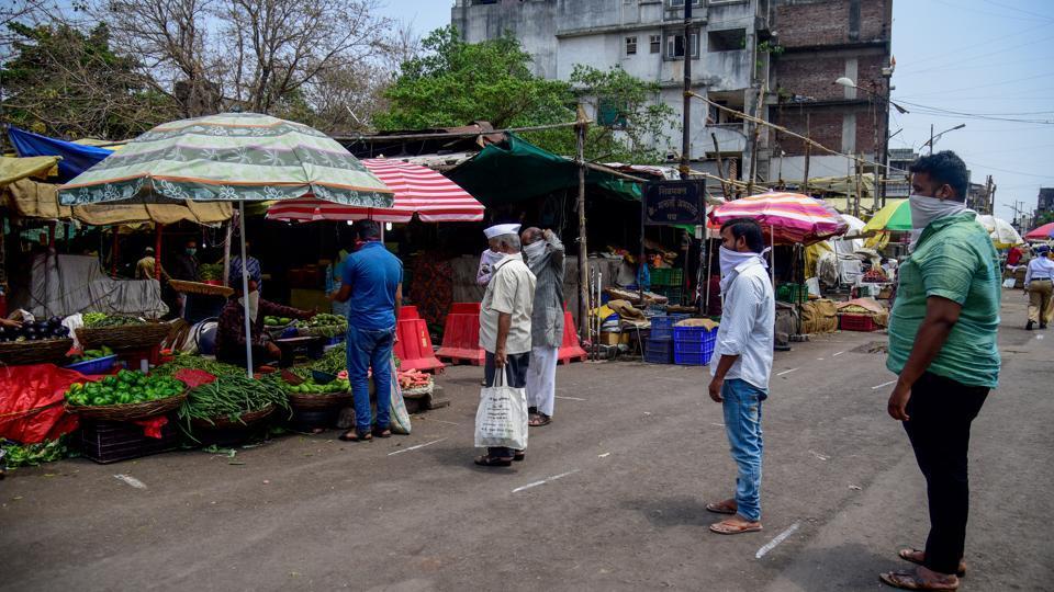 People practising social distancing at Mandai vegetable market in Pune on Wednesday.