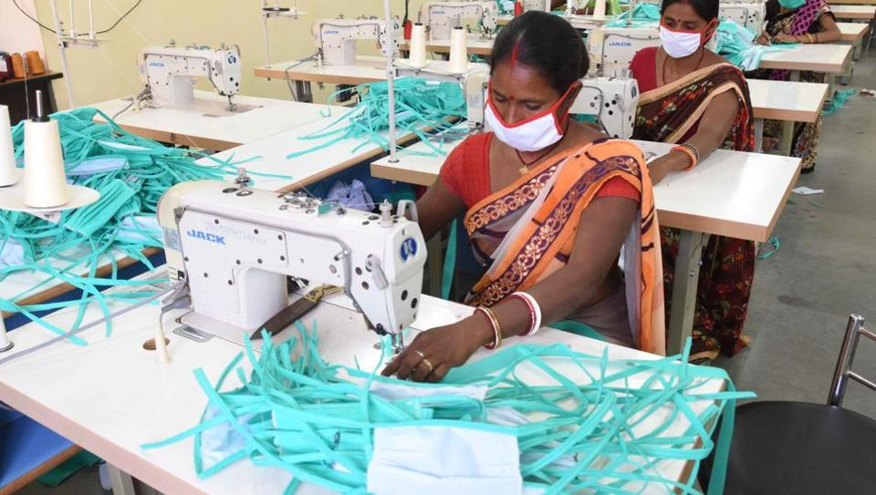 Members of self help group -- Sakhi Mandal stich protective masks amid rising coronavirus concerns at Jharkhand Rural development training centre in Ranchi on Wednesday.