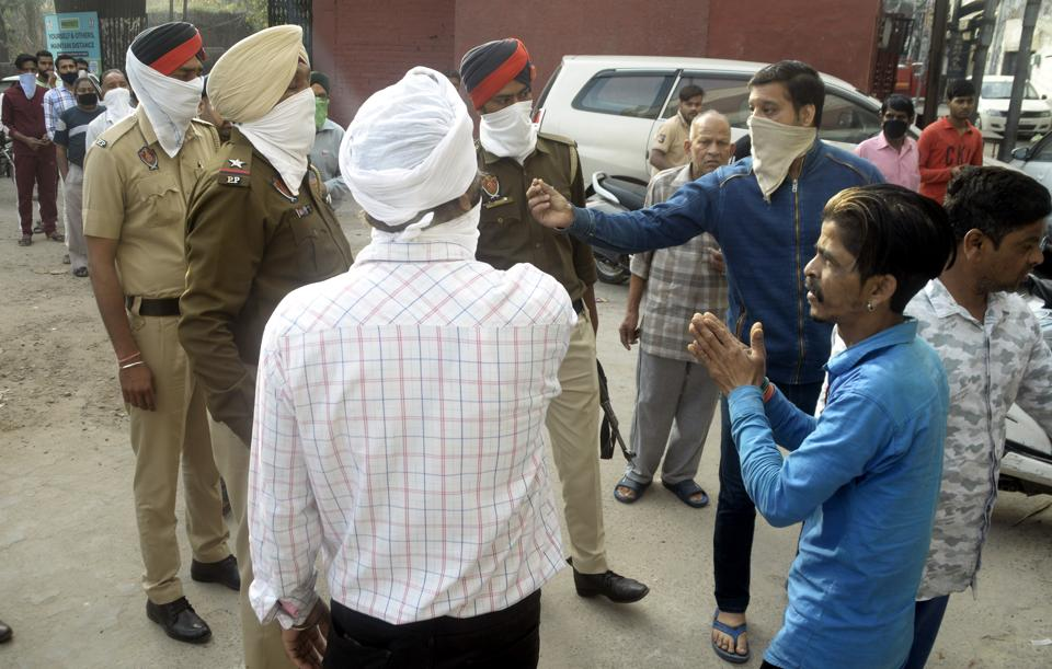 Police dispersing residents huddled outside a flour mill at Chhawani Mohalla in Ludhiana on Thursday.