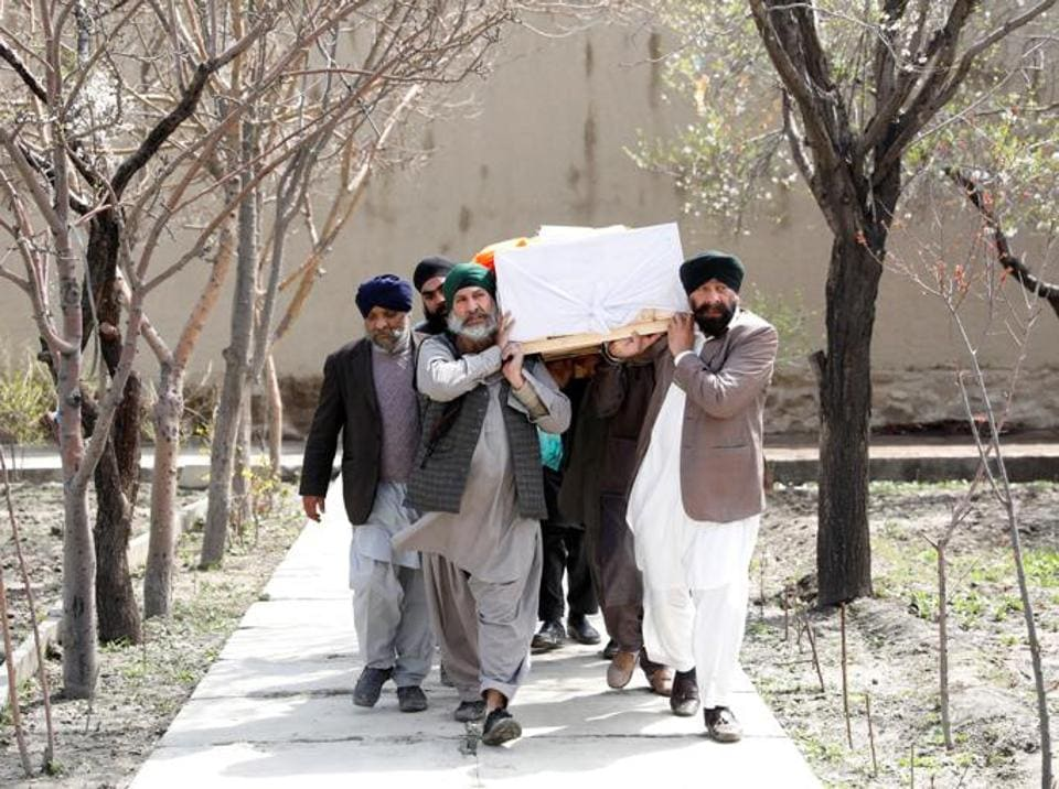 Sikhs carrying the coffin of a victim who was killed in the terror attack at a gurdwara in Kabul, Afghanistan.
