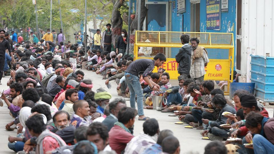 Homeless and poor receive food at a government shelter in New Delhi.