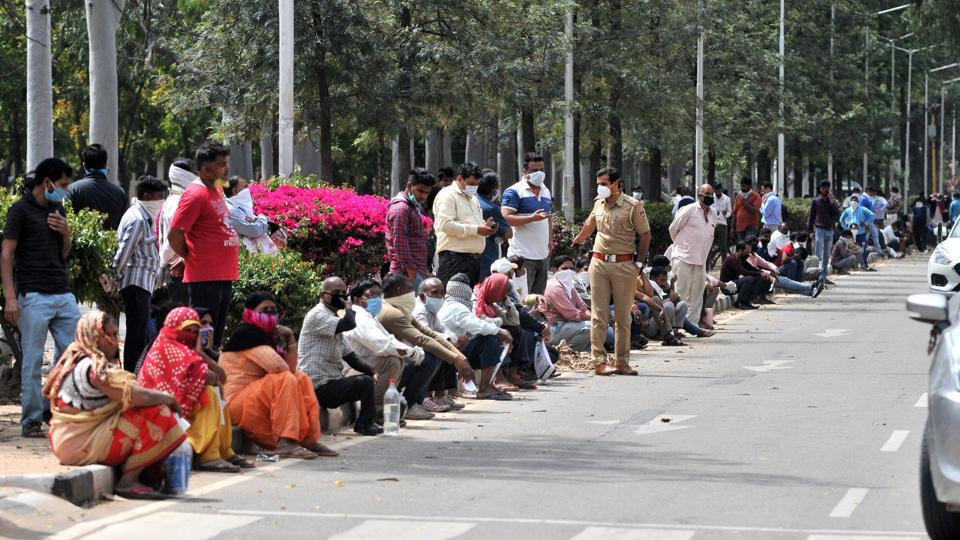 Vendors assembled for curfew passes outside the MC office in Sector 17, Chandigarh, on Thursday. Though most were armed with masks, they were flouting the social distancing norms.