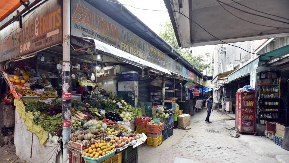 A view of a vegetable market at Delhi's CR Park Market No 2 on the second day of national lockdown to curb the spread of coronavirus.