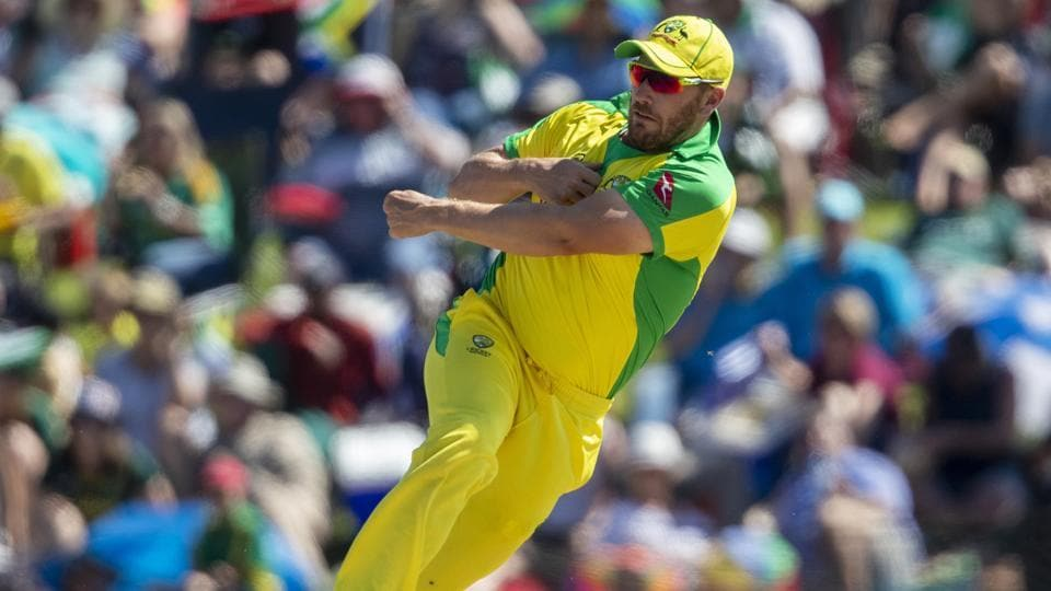 Australia's captain Aaron Finch throws the ball as he attempts a run out.